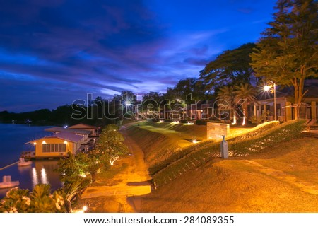 Cozy resort by the river at night,slow speed shutter blurred - stock photo