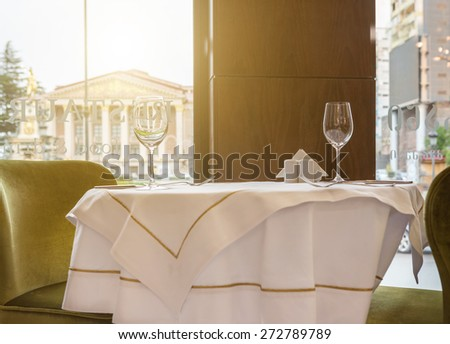Cozy restaurant two person table - stock photo