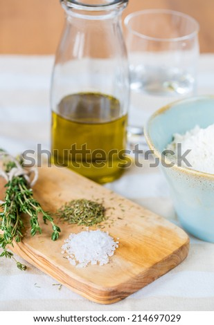 Cozy rustic home kitchen still life, dried herbs thyme, salt. - stock photo