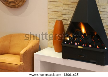 Cozy seeting with a modern gas fireplace - stock photo