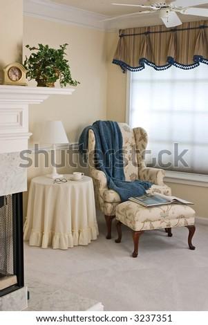 Cozy sitting area in master bedroom - stock photo