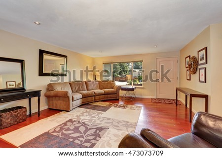 Cozy Spacious living room with cherrywood floor. Entrance door view. Northwest, USA