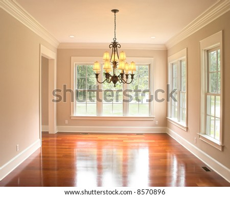 cozy unfurnished dining room with lots of windows - stock photo