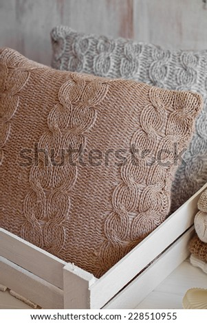 Cozy wool winter accessory. Warm pillow - stock photo