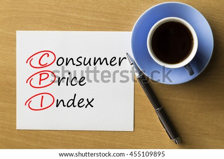 CPI Consumer Price Index - handwriting on paper with cup of coffee and pen, acronym business concept