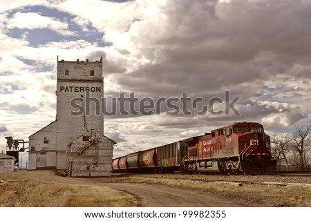 CPR grain train passing by old Parkbeg grain elevator - stock photo