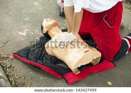 CPR training - heart massage - stock photo