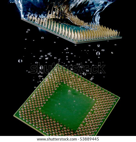 CPU dropped in to the water - stock photo