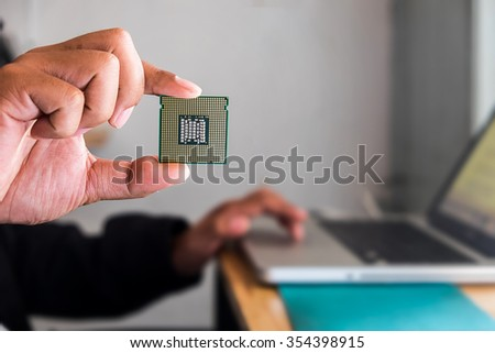 CPU in hand with office background and vintage effect. - stock photo