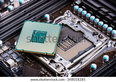 CPU socket and processor on the motherboard - stock photo
