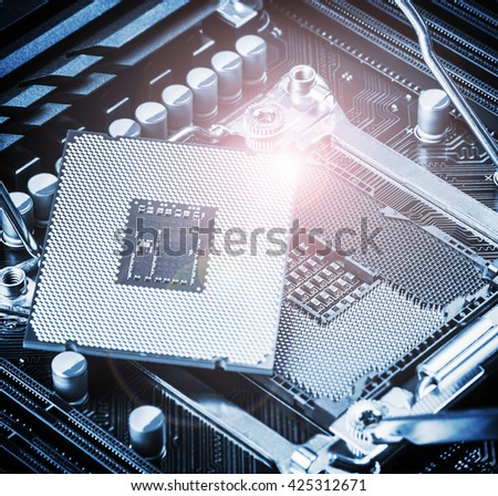 CPU socket and processor on the motherboard. Focus on the motherboard. Toned image - stock photo