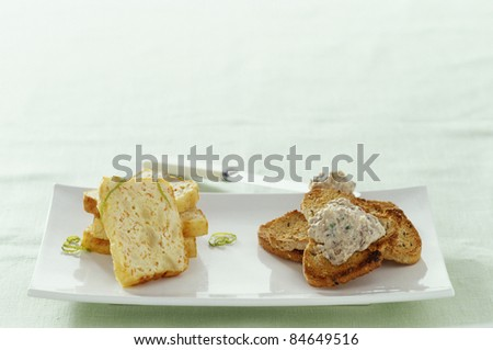 Crab and lime terrine, sardine and black olive mousse - stock photo