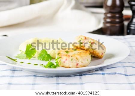 Crab Cakes with mashed potato. Stock image. - stock photo