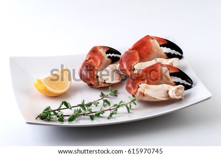 Crab claws in white plate.