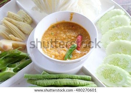 Crab eggs dip, Thailand. A dip or dipping sauce is a common condiment for many types of food. Dips are used to add flavor or texture to a food.