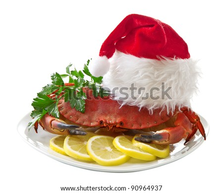 Crab in Santa Claus hat on a platter isolated on white background - stock photo