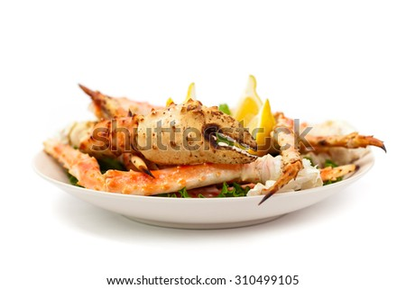 Crab Legs on white background. Selective focus. - stock photo