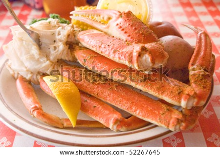 Crab legs seafood platter with sides - stock photo