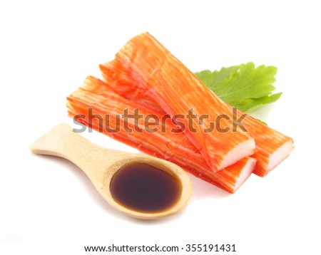Crab meat and sauce on white background