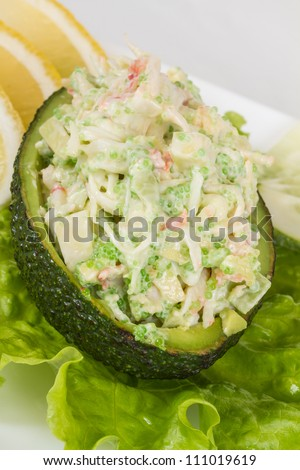 Crab meat salad with green caviar in avocado - japan cusine