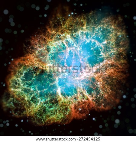 Crab Nebula is a six-light-year-wide remnant of a star's supernova explosion. A rapidly spinning neutron star, in the center bluish glow. Image with small DOF. Elements of this image furnished by NASA - stock photo