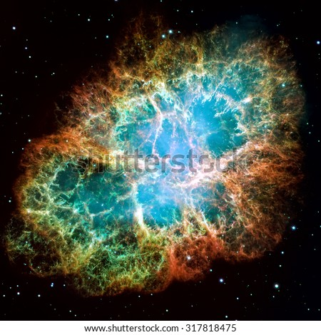 Crab Nebula is a six-light-year-wide remnant of a star's supernova explosion. A rapidly spinning neutron star, in the center bluish glow. Retouched image. Elements of this image furnished by NASA - stock photo