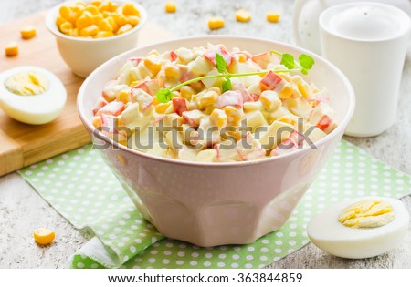 Crab salad with corn, eggs and mayonnaise on white table, selective focus