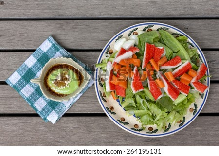 Crab stick salad with wasabi dressing  - stock photo