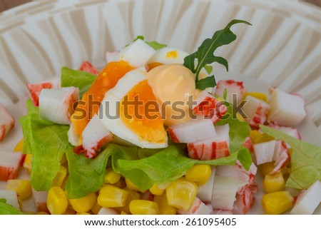 Crab sticks salad with egg and corn