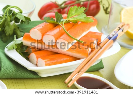 crab sticks with chopsticks in color table