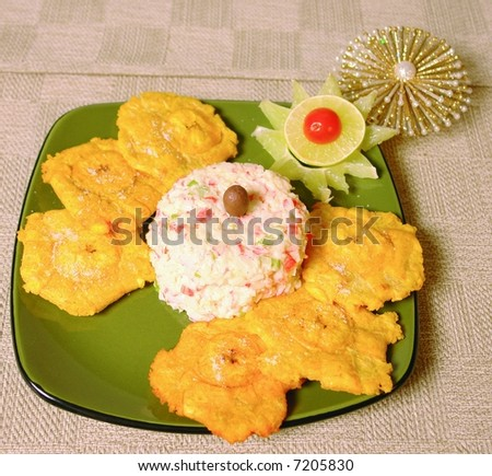 Crabmeat imitation dip with fried plantain chips - stock photo
