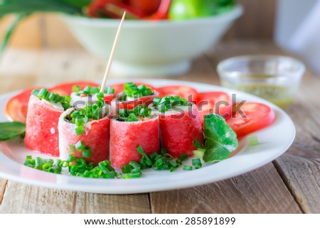 Crabstick Veggie Roll - Fish Tofu Filling On Wood Table - stock photo