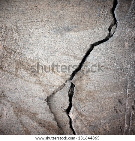 crack at cement wall ; grunge background - stock photo