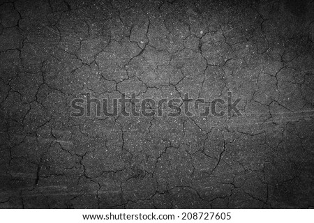 crack background texture of rough asphalt  - stock photo