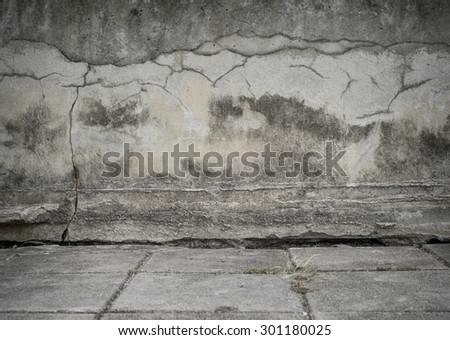 Crack Concrete wall with brick stone street road, background - stock photo