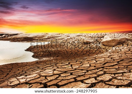 Crack earth with water - stock photo