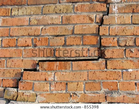 Crack in the Brickwall - stock photo