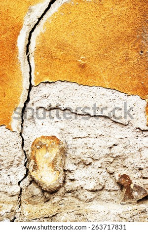 Crack in the house in ruins - wall of house destroyed during earthquake - stock photo