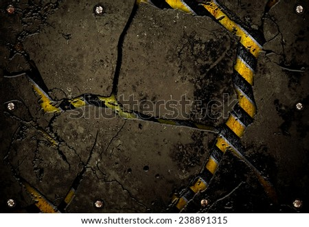 crack metal plate with warning stripes  - stock photo