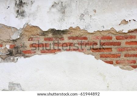 crack on brick wall - stock photo