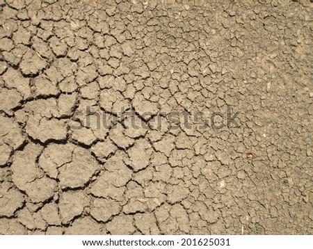 crack on dry soil  background - stock photo