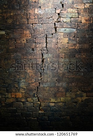 crack on old bricks wall background,grunge background,abstract background - stock photo