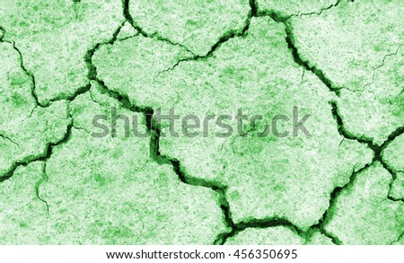 Crack soil on dry season, Global warming / cracked dried mud / Dry cracked earth background / The cracked ground, Ground in drought, Soil texture and dry mud, Dry land. - stock photo