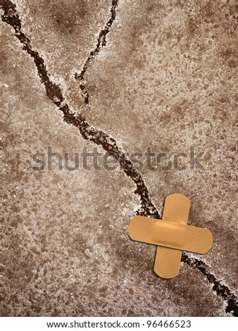 crack whit sticking plaster - stock photo