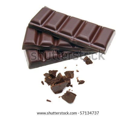 Cracked and stacked dark chocolate with crushed parts - stock photo