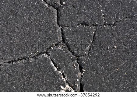cracked asphalt - stock photo