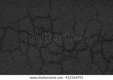 Cracked asphalt pavement background. - stock photo