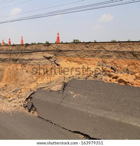 Cracked asphalt road - stock photo