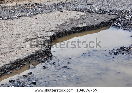 Cracked asphalt road close up - stock photo