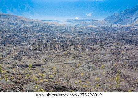 Cracked barren bottom of Kilauea Crater in Hawaii Volcanoes National Park, Big Island, Hawaii - stock photo